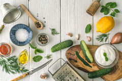 Ingredients for tzatziki preparation on the white  wooden table  top view Royalty Free Stock Photo