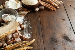 Ingredients and utensils for pasta making. On a wooden background Royalty Free Stock Photo