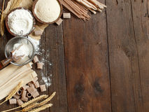 Ingredients and utensils for pasta making. On a wooden background Stock Photos