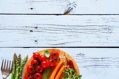 Ingredients for vegan cooking. Raw ingredients for diet cooking or salad making on white wooden kitchet table. Top view. Flat lay style. Clean eating, vegan Stock Image