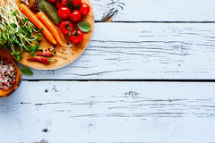 Ingredients for vegan cooking. Top view of fresh raw ingredients for diet cooking or salad making on white wooden kitchet table. Flat lay style. Healthy, clean Royalty Free Stock Photo