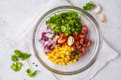 Ingredients for vegan meatballs from beans and corn in glass bow. L, top view. Plant based diet concept royalty free stock image
