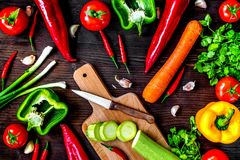 Ingredients for vegetable ragout on wooden background top view stock photography