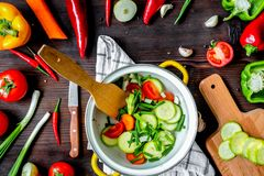 Ingredients for vegetable ragout on wooden background top view royalty free stock photography