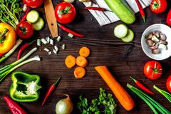 Ingredients for vegetable ragout on wooden background top view royalty free stock image
