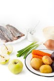 Ingredients for vegetable salad with apple and fish  on the white background vertical Stock Photography