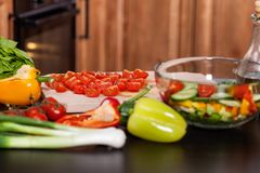 Ingredients of a vegetable salad on the kitchen table Royalty Free Stock Photos