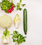Ingredients for vegetables salad on white wooden background Stock Images