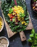 Ingredients for vegetarian chard packets. Chard leaves stuffed with turmeric lentils and vegetables. Vegetarian healthy food Stock Images