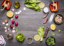 Ingredients for a vegetarian meal lettuce leaves on a lemon pepper garlic sliced radishes space text rustic wooden backgrou. Ingredients for a vegetarian meal Royalty Free Stock Image