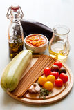 Ingredients for wholegrain pasta with vegetables and beans. On the desk stock image