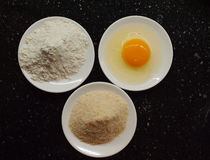 Ingredients for Wiener Schnitzel. Breadcrumbs, raw egg and wheat flour - ingredients for frying Wiener Schnitzel Stock Image