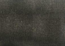 Ingrepp för kanfas för Textureof tygsäckväv som naturligt brunt isoleras på svart bakgrund bakgrund för makrotexturmodell Royaltyfri Fotografi
