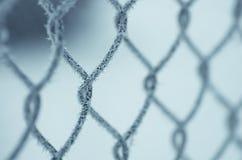 Ingreppsstaket som täckas med snö Fotografering för Bildbyråer