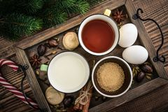 Ingridients for eggnog. Ingridients for traditional christmas drink eggnog on tray on wooden background, top view royalty free stock images