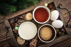 Ingridients for eggnog. Ingridients for traditional christmas drink eggnog on tray on wooden background, top view royalty free stock photos