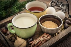 Ingridients for eggnog. Ingridients for traditional christmas drink eggnog on tray on wooden background royalty free stock photography