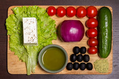 Ingridients for Greek salad. With fresh vegetables, feta cheese and black olives stock images