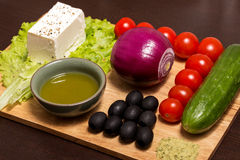Ingridients for Greek salad. With fresh vegetables, feta cheese and black olives stock photography
