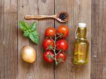 Ingridients for italian tomato sauce. Tomatoes, onion, basil, extra vergin olive oil and pepper royalty free stock images