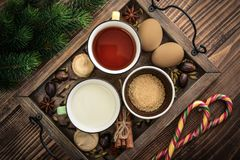 Ingridients for eggnog. Ingridients for traditional christmas drink eggnog on tray on wooden background, top view stock images