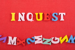 INGUEST word on red background composed from colorful abc alphabet block wooden letters, copy space for ad text Stock Photos