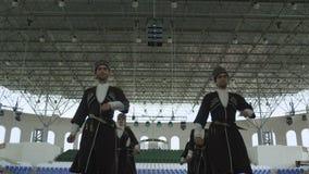 Ingushetia Folk Men Ensemble in Black Costumes Dances stock footage