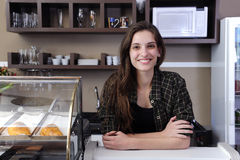 Inhaber eines Kaffee oder der Kellnerin Stockbilder