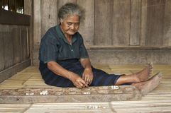 Inhabitant of Flores playing congkak Royalty Free Stock Photography