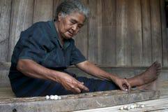 Inhabitant of Flores playing congkak Royalty Free Stock Photos