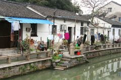 Daily life along the canal in ancient water town Suzhou, China Royalty Free Stock Images