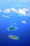 Inhabited and green islands. On the indian ocean, Maldives Royalty Free Stock Photos