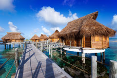 Inhabited wooden lodges on piles stand in an island lagoon Stock Photography