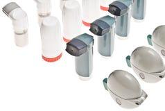 Inhaladores plásticos coloreados aislados Fotografía de archivo libre de regalías