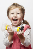 Inhalation. Little girl being happy that she finally is able to breath Stock Image