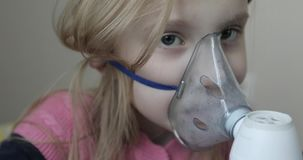 Inhalation mask on her face. stock video