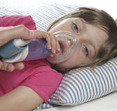 Inhaler. Little girl with inhaler - respiratory problems for asthma Royalty Free Stock Photography