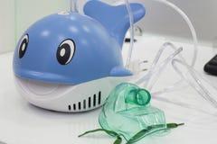 Inhaler. Nebulizer inhaler on white reflection background, Medical healthcare concept Royalty Free Stock Images