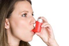 Inhaler Woman. Young woman using medical inhaler stock photo