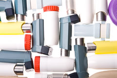 Inhalers background. Background of Colored plastic inhalers Stock Images