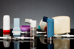Inhalers and syringes. On a dark background Royalty Free Stock Images