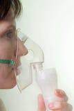 Inhaling mask Stock Image