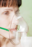Inhaling mask Stock Photography