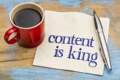 Inhalt ist König - Anzeige auf Serviette Stockfotografie