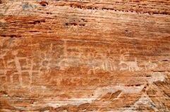 Inheemse Amerikaanse rotstekening op canionmuur Stock Foto
