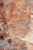 Inheemse Amerikaanse rotstekening op canionmuur Stock Foto's