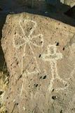 Inheemse Amerikaanse rotstekeningen die een beeld van kruisen kenmerken bij Rotstekenings Nationaal Monument, buiten Albuquerque, Stock Fotografie