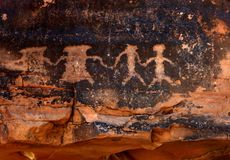 Inheemse Amerikaanse Rotstekeningen in Rood Zandsteen Royalty-vrije Stock Afbeeldingen
