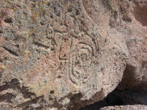 Inheemse Amerikaanse spiraalvormige rotstekening Tsankawe New Mexico Stock Afbeelding