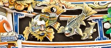 Inheemse kunst die op de muur wordt gesneden. Stock Foto's